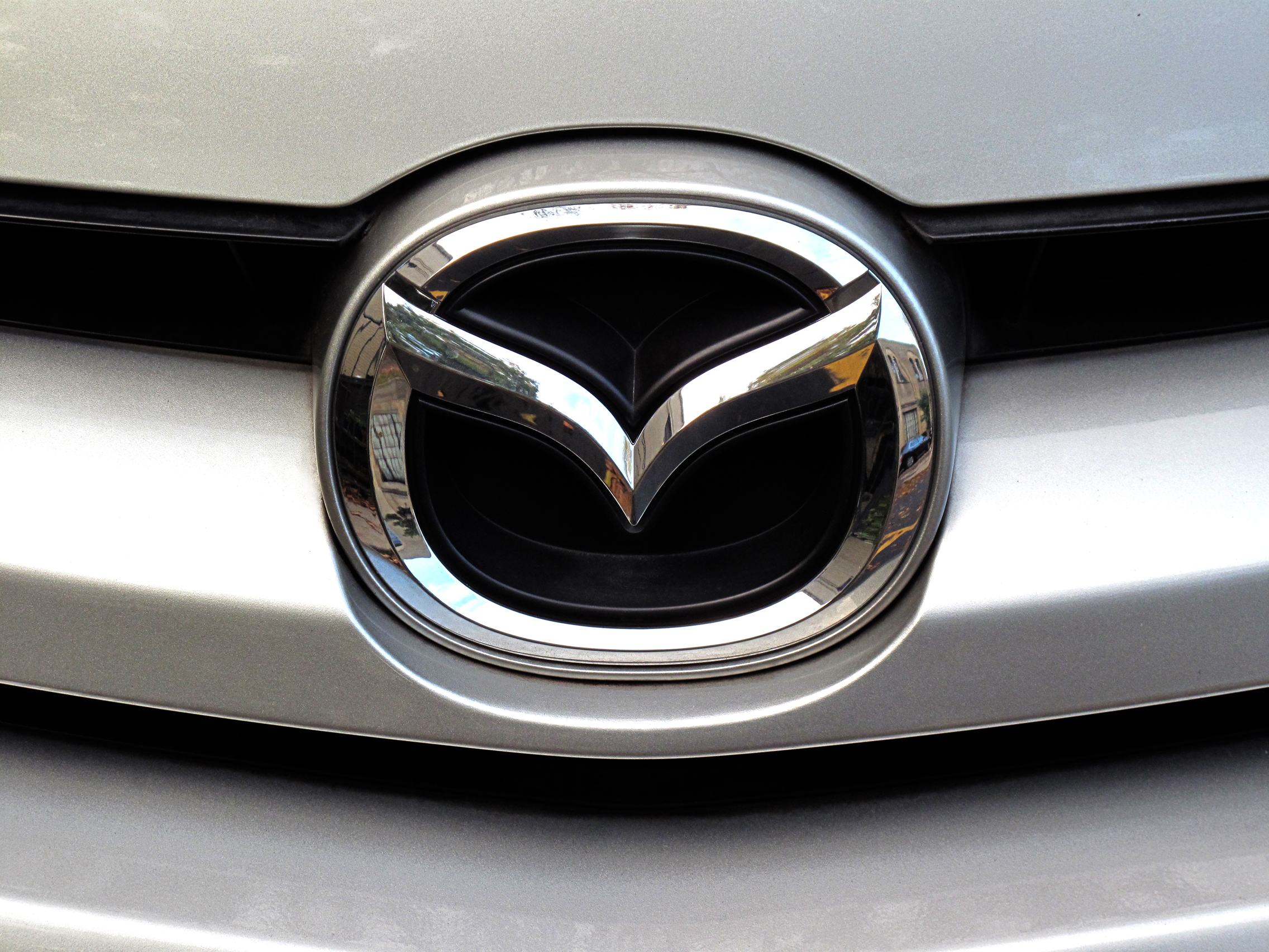 mazda logo on front of car