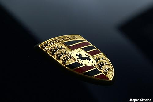 Porsche logo mounted on a car body