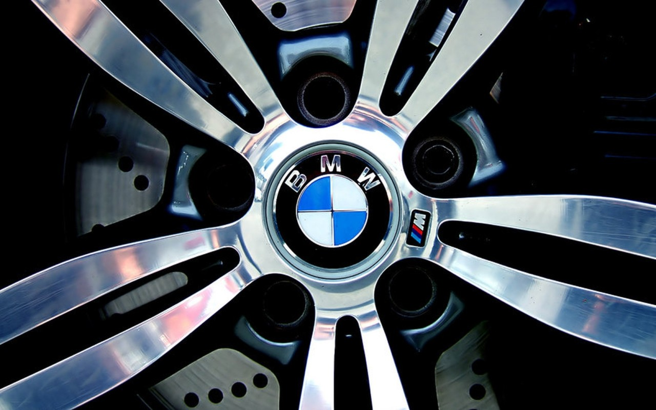 Bmw logo is visible in the car wheel